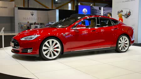 tesla model s : BRUSSELS, BELGIUM - JANUARY 12, 2016: Tesla Model S full electric luxury car at the 2016 Brussels Motor Show. Stock Footage