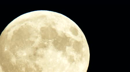 carrancudo : Full moon close up during an early evening. The moon is moving from low left to up right. Stock Footage