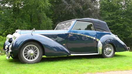 mês : Delahaye 135 MS, 2 seater classic convertible car by Pennock, 1948 on display during 2016 Classic Days at Dyck castle in Germany. Stock Footage