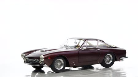 lusso : Ferrari 250 GT Berlinetta Lusso 1960s classic sports car scale model car by Hotwheels rotating against a white background. Stock Footage