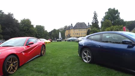 lusso : Ferrari F12 Berlinetta and Ferrari GTC4 Lusso Grand Tourer Italian sports car on display during the 2017 Classic Days event at Schloss Dyck. People in the background are looking at the cars. Stock Footage