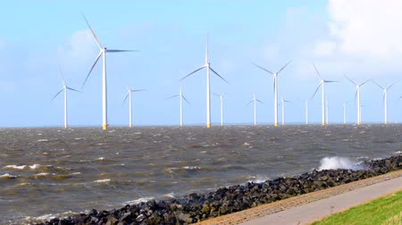 levee : Offshore Windturbines in an October fall storm at the IJsselmeer in The Netherlands.