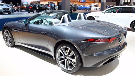 roadster : Jaguar F-Type Convertible British sports car on display at the 2018 European motor show in Brussels. Stock Footage