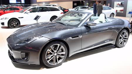 car dealership : Jaguar F-Type Convertible British sports car on display at the 2018 European motor show in Brussels. Stock Footage