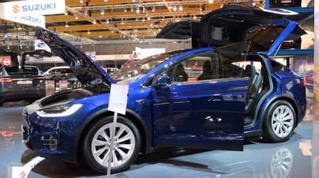 tesla model s : Tesla Model X crossover SUV all-electric, luxury car with open doors during the 2018 European Motor Show Brussels.