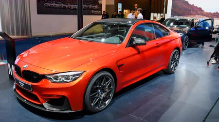 двухместная карета : BMW M4 sports car on display during the 2018 European Motor Show Brussels. The M4 is the M Performance version of the BMW 4-series.
