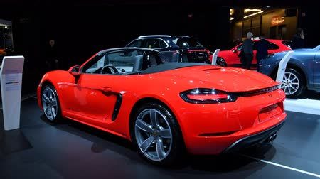 roadster : Porsche 718 Boxster convertible sports car in bright red on display at the 2018 European motor show in Brussels.