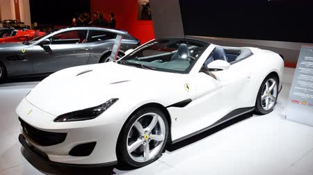 kiállítási terem : Ferrari Portofino grand touring two-door 2+2 hard top convertible sports car and Ferrari 812 Superfast on display at the 2018 European motor show in Brussels.