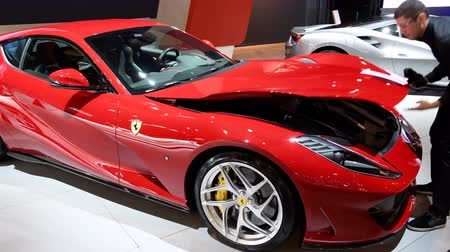 tourer : Ferrari 812 Superfast V12 exclusive Grand Tourer sports car being polished during 2018 European motor show in Brussels. Stock Footage