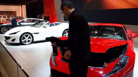 gt : Ferrari 812 Superfast V12 exclusive Grand Tourer sports car being polished during 2018 European motor show in Brussels. Stock Footage