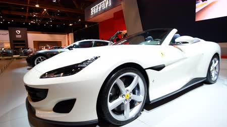gt : Ferrari Portofino grand touring two-door 2+2 hard top convertible sports car and Ferrari 812 Superfast on display at the 2018 European motor show in Brussels.