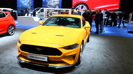 gt : Ford GT Supercar and Ford Mustang performance car on display at the 2018 European motor show in Brussels. Stock Footage