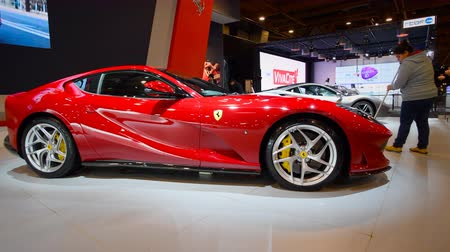 tourer : Ferrari 812 Superfast V12 front mid-engine, rear-wheel-drive exclusive Grand Tourer sports car on display at the 2018 European motor show in Brussels.