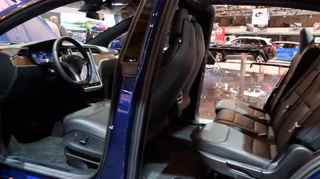 sólyom : Tesla Model X all-electric, luxury, crossover SUV car interior with open doors during the 2018 European Motor Show Brussels.