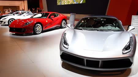 gt : Ferrari 488 GTB two-door coupe and Ferrari 812 Superfast sports cars on display at the 2018 European motor show in Brussels.