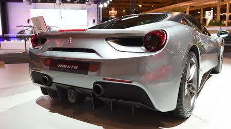двухместная карета : Ferrari 488 GTB two-door coupe sports car on display at the 2018 European motor show in Brussels. Стоковые видеозаписи
