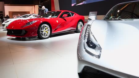 tourer : Ferrari 812 Superfast sports car and Ferrari 488 GTB two-door coupe sports car on display at the 2018 European motor show in Brussels.