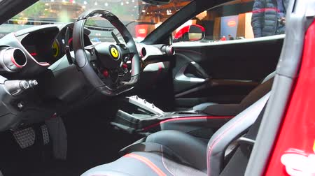 двухместная карета : Ferrari 812 Superfast sports car dashboard and interior on display at the 2018 European motor show in Brussels.