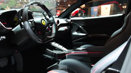tourer : Ferrari 812 Superfast sports car dashboard and interior on display at the 2018 European motor show in Brussels.