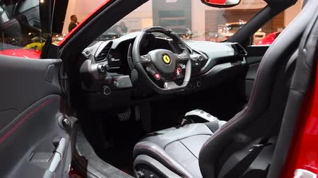 tourer : Ferrari 488 Spider two-door hard top convertible sports car interior and dashboard on display at the 2018 European motor show in Brussels.