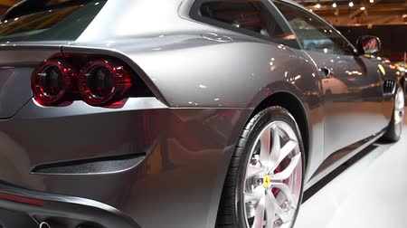 kiállítási terem : Ferrari GTC4Lusso Gran Turismo sport car on display at the 2018 European motor show in Brussels. Stock mozgókép