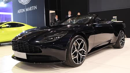 gt : Aston Martin DB11 Convertible exclusive Grand Tourer sports car on display at the 2018 European motor show in Brussels. Stock Footage