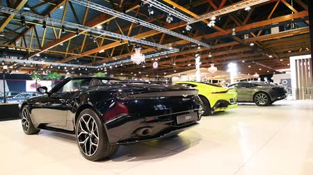gt : Aston Martin Vantage in bright green and DB11 Convertible exclusive Grand Tourer sports cars on display at the 2018 European motor show in Brussels.