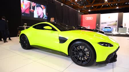 gt : Aston Martin Vantage in bright green exclusive Grand Tourer sports car on display at the 2018 European motor show in Brussels. Stock Footage