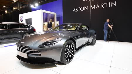 tourer : Aston Martin DB11 Coupe exclusive Grand Tourer sports car on display at the 2018 European motor show in Brussels.