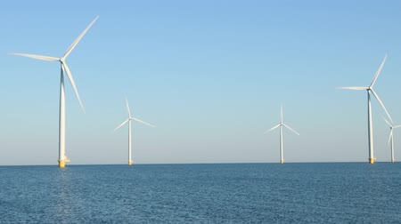 dioxid : Wind turbines with turning blades in the wind in an offshore windpark.