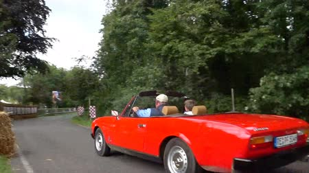 kabriolet : Peugeot 504 Convertible classic car driving on a country road. The car is doing a demonstration drive during the 2017 Classic Days. Wideo