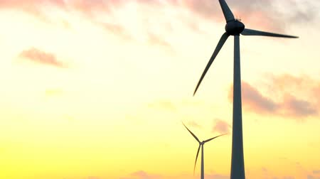 carbon dioxide : Wind turbines with turning blades in the wind in an offshore windpark during sunset.