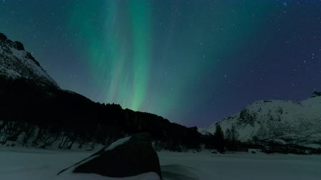 holdfény : Northern Lights, polar light or Aurora Borealis in the night sky over Vesteralen islands in Northern Norway time lapse.