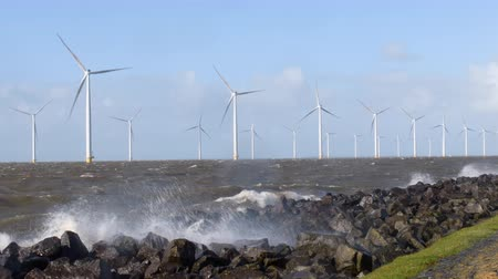 levee : Windturbines in a winter storm at the IJsselmeer in The Netherlands. Stock Footage
