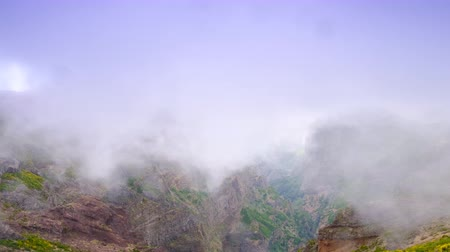 miradouro : Clouds over the mountains on Madeira island at the Ninho da Manta, or Eagle's Nest. Fast forward clip.