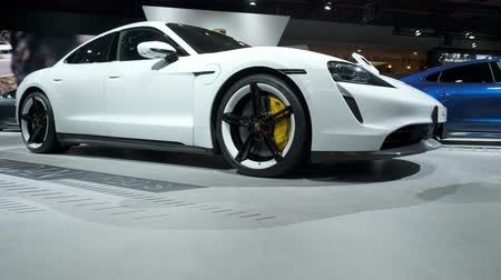 melez : BRUSSELS, BELGIUM - JANUARY 9: Porsche Taycan Turbo S all-electric luxury performance car on display at Brussels Expo Stok Video