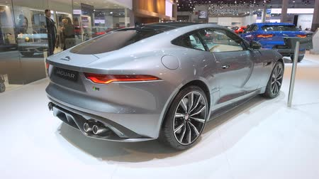 モーターショー : BRUSSELS, BELGIUM - JANUARY 9: Jaguar F-Type Coupe 2020 facelift sports car on display at Brussels Expo. Handheld gimbal shot at the rear of the car.