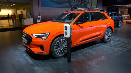 crossover : BRUSSELS, BELGIUM - JANUARY 9: Audi e-tron 55 Quattro full electric luxury crossover SUV car on display at Brussels Expo. Handheld gimbal shot.