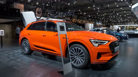 crossover : BRUSSELS, BELGIUM - JANUARY 9: Audi e-tron 55 Quattro full electric luxury crossover SUV car on display at Brussels Expo. Handheld gimbal shot around the car.