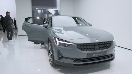 melez : BRUSSELS, BELGIUM - JANUARY 9: Polestar 2 all-electric 5-door fastback car in grey on display at Brussels Expo. Handheld gimbal shot around the car. Stok Video