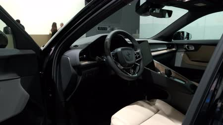 kupé : BRUSSELS, BELGIUM - JANUARY 9, 2020: Polestar 2 all-electric 5-door fastback car interior on display at Brussels Expo. Handheld gimbal shot around the car.