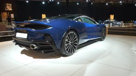 gran turismo : BRUSSELS, BELGIUM - JANUARY 8, 2020: McLaren GT exclusive sports car on display at Brussels Expo. Handheld gimbal shot.