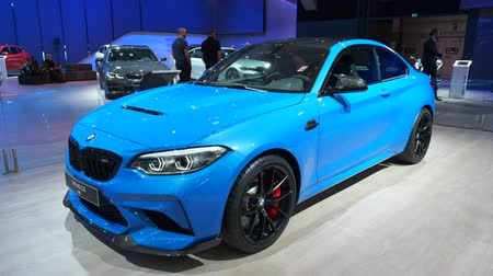 bruxelas : BRUSSELS, BELGIUM - JANUARY 9, 2020: BMW M2 CS compact sedan performance car on display at Brussels Expo. Handheld gimbal shot. Stock Footage