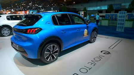 kompakt : BRUSSELS, BELGIUM - JANUARY 9, 2020: Peugeot e-208 all electric compact hatchback car on display at Brussels Expo