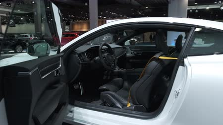クーペ : BRUSSELS, BELGIUM - JANUARY 8, 2020: Polestar 1 hybrid sports car coupe interior on display at Brussels Expo. Polestar is the performance company and brand of Volvo Cars. Handheld gimbal shot.