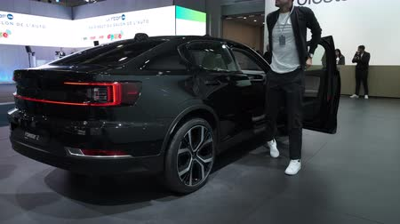 melez : BRUSSELS, BELGIUM - JANUARY 9, 2020: Polestar 2 all-electric 5-door fastback car in black on display at Brussels Expo. Handheld gimbal shot around the car. Stok Video