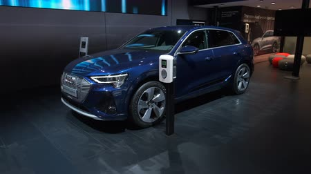 melez : BRUSSELS, BELGIUM - JANUARY 9: Audi e-tron 50 Quattro full electric luxury crossover SUV car on display at Brussels Expo Stok Video