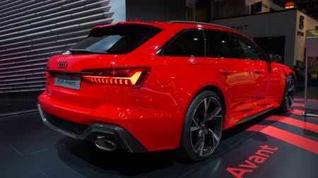 durum : BRUSSELS, BELGIUM - JANUARY 8, 2020: Audi RS6 Avant performance station wagon in bright red on display at Brussels Expo. Rear view shot.
