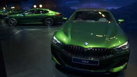 durum : BRUSSELS, BELGIUM - JANUARY 9, 2020: BMW 8 Series M850i xDrive Gran Coupe fastback on display at Brussels Expo Stok Video