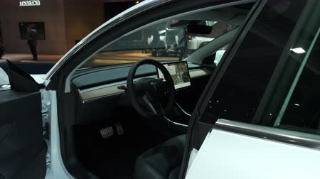 tesla car : BRUSSELS, BELGIUM - JANUARY 9, 2020: Tesla Model 3 compact sedan car interior on display at Brussels Expo